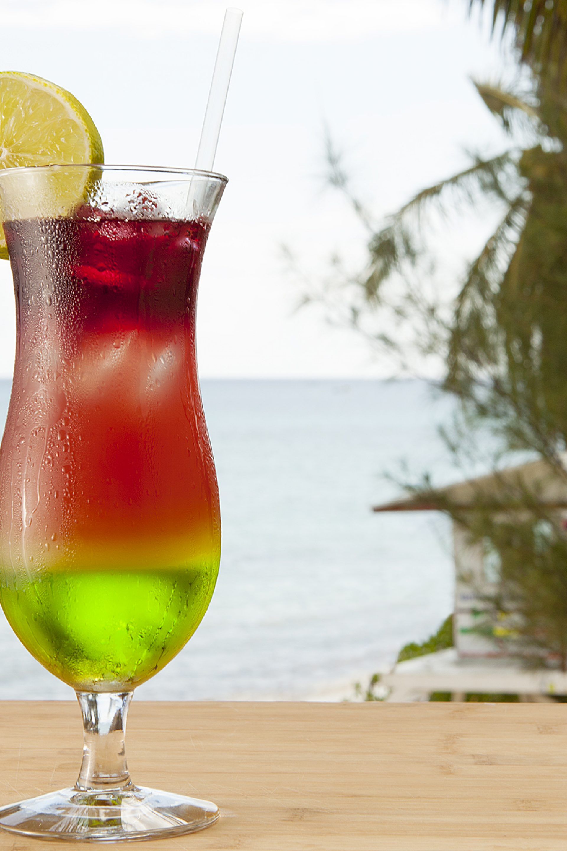 Experience paradise with island cocktails on private balcony at Mahekal Beach Resort