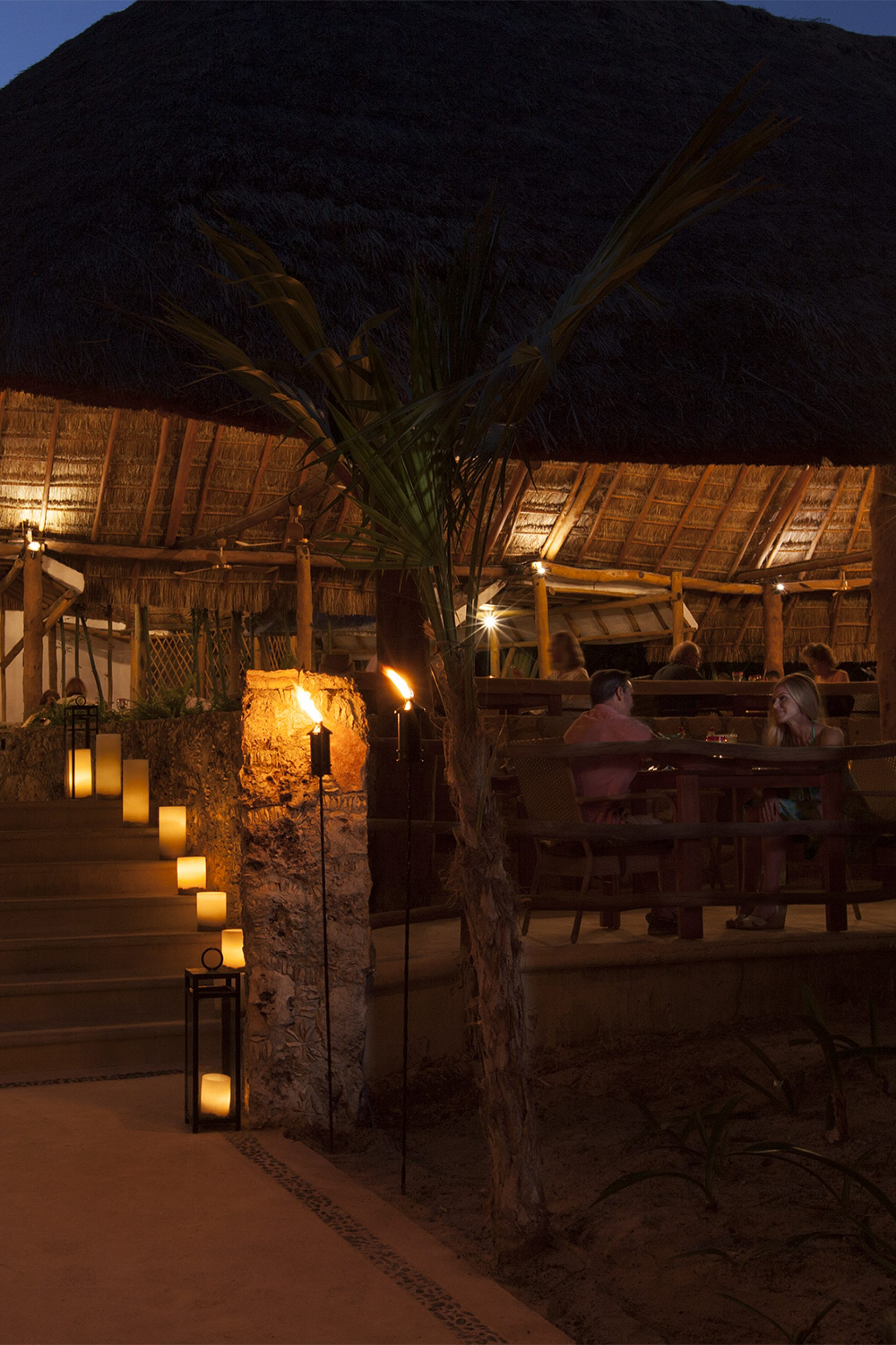 Outdoor Dining under a Palapa roof in the Mayan Jungle at Cocina Restaurant