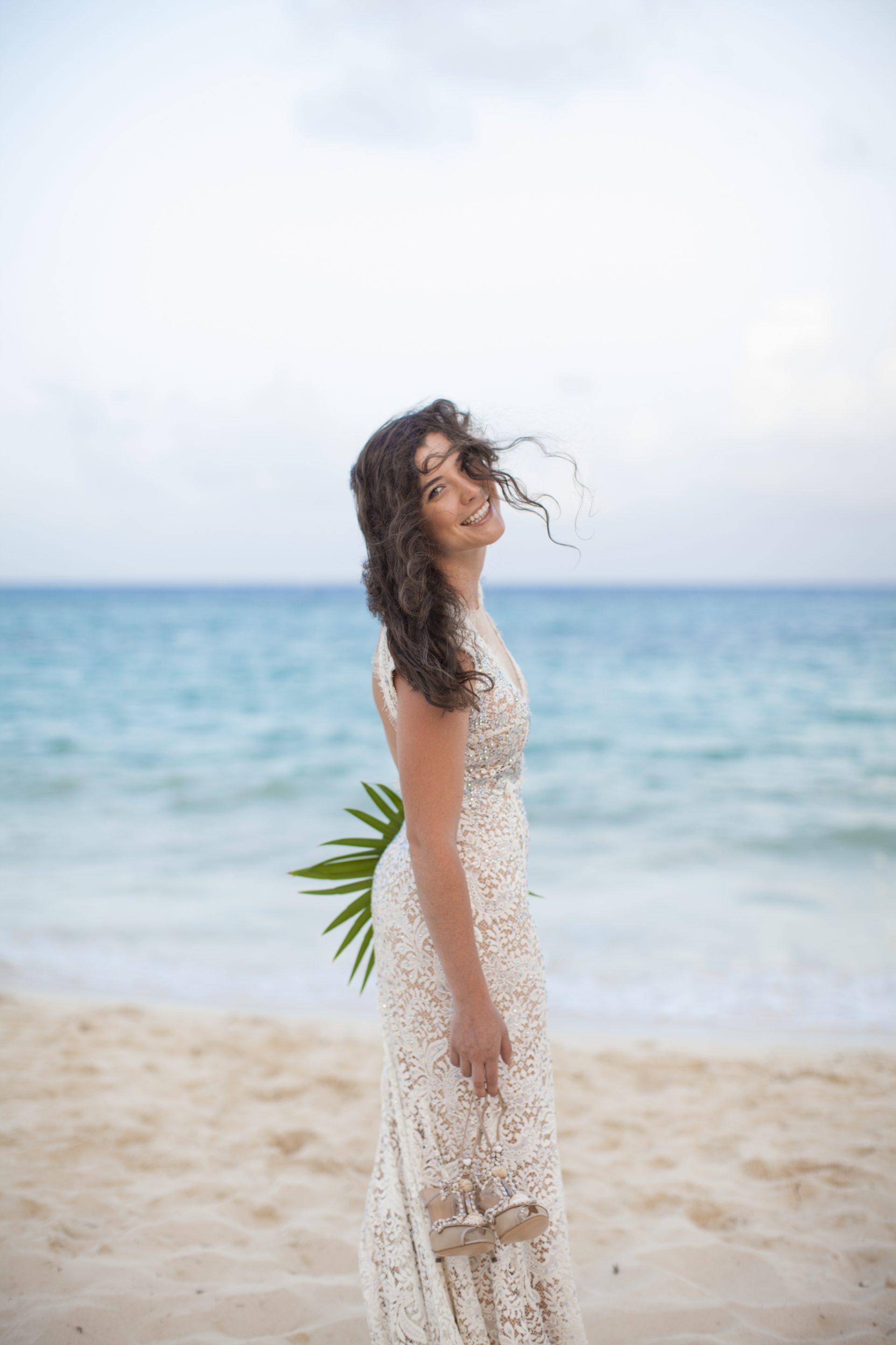 Bride with long hair by the beach