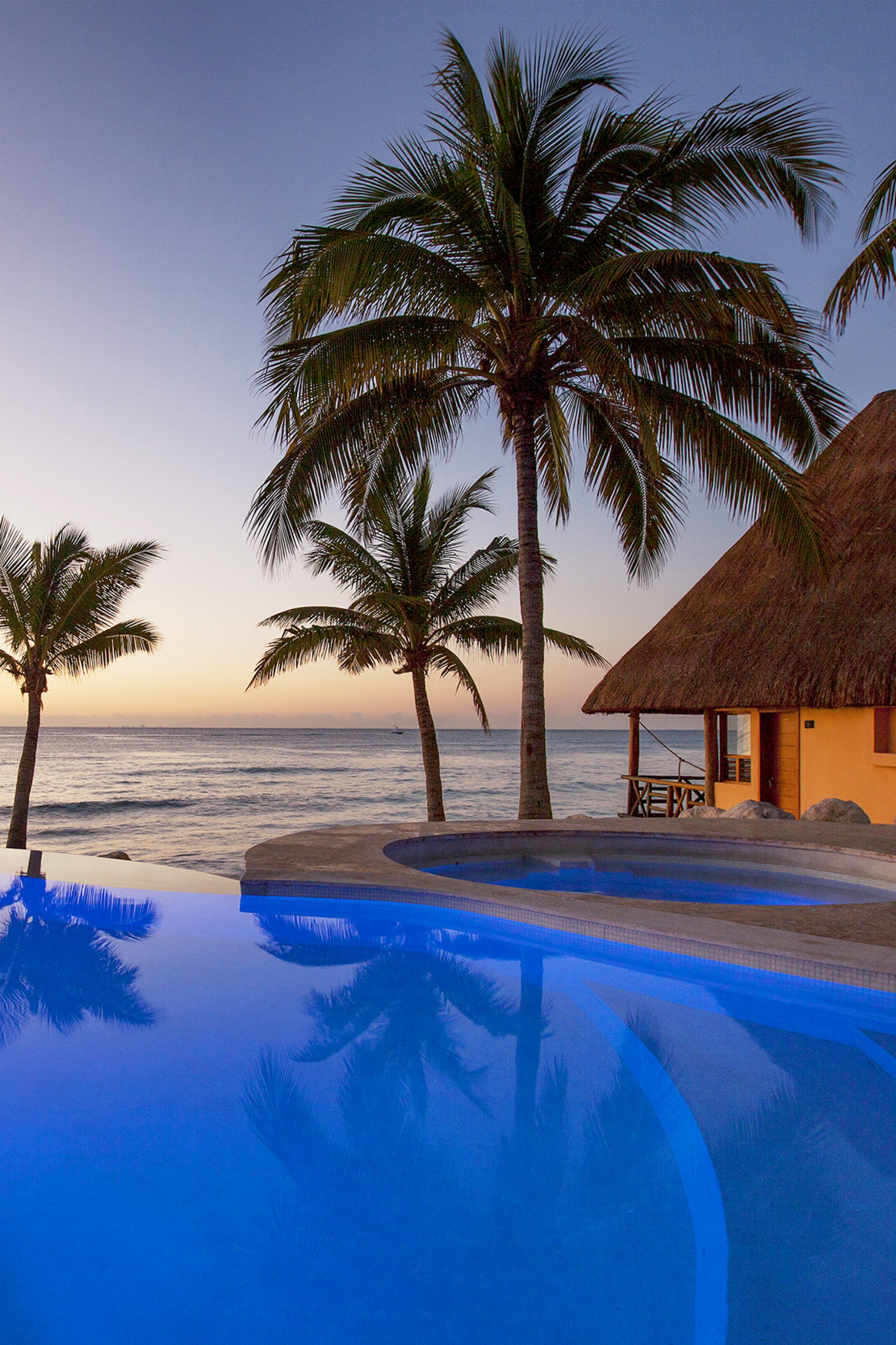 Resort-style infinity pool overlooking the Caribbean at Mahekal Beach Resort