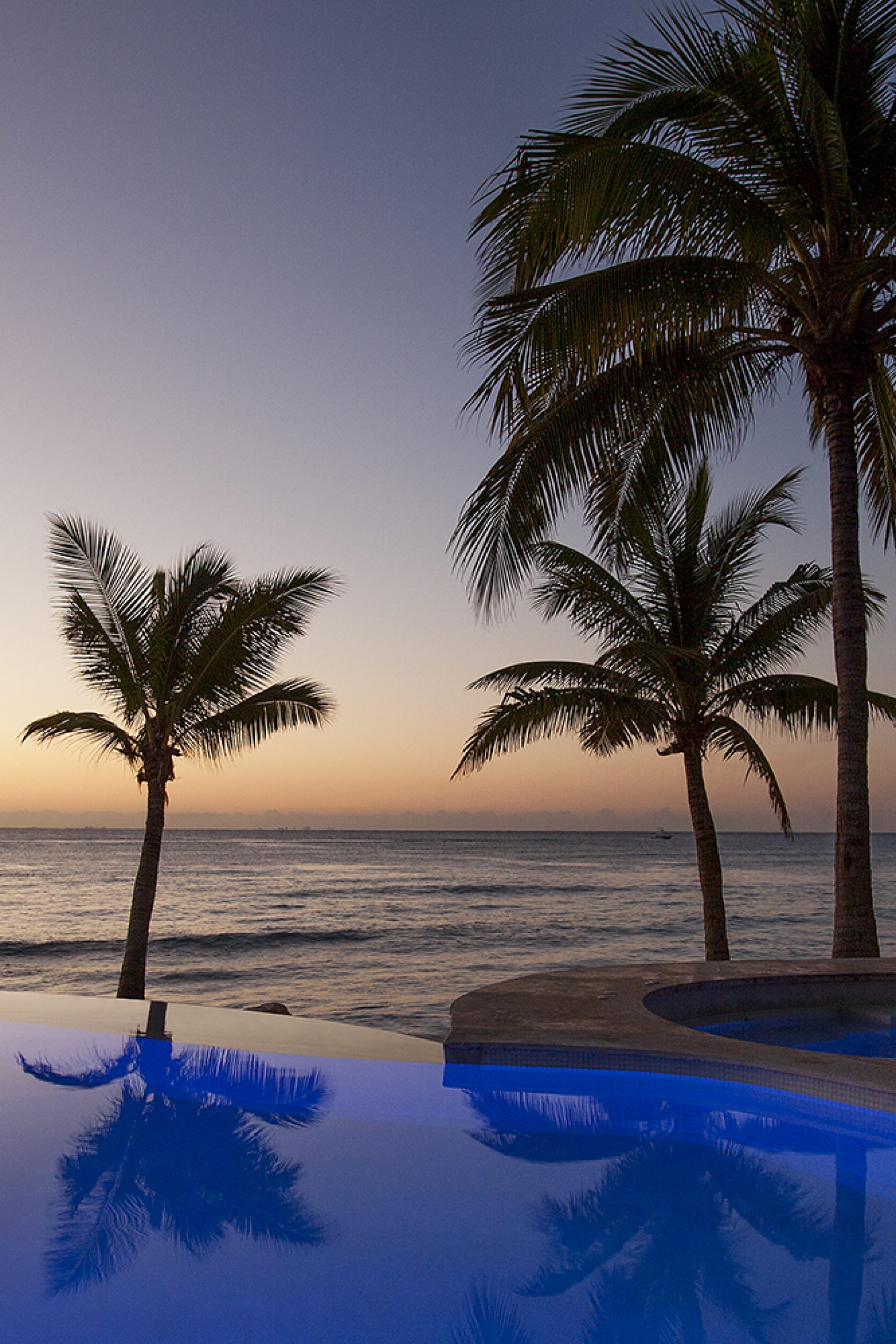 Las Olas Pool with ocean sunrise at Mahekal Beach Resort