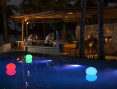Poolside drinks under the stars at Mahekal Beach Resort