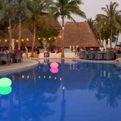 Poolside dinner under the stars at Mahekal Beach Resort